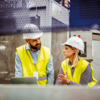 f3 man and woman in manufacturing facility