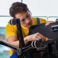 f3 repairman fixing desk chair